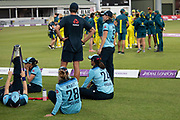 Australia celebrate as England warm down after the Royal London Women's One Day International match between England Women Cricket and Australia at the Fischer County Ground, Grace Road, Leicester, United Kingdom on 4 July 2019.