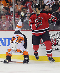May 6, 2012; Newark, NJ, USA; Philadelphia Flyers right wing Matt Read (24) gets hit by New Jersey Devils defenseman Bryce Salvador (24) during the first period in game four of the 2012 Eastern Conference semifinals at the Prudential Center.