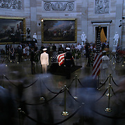 Mourners walk past the casket of President Reagan in the Rotunda of the US Capitol Thursday, June 10, 2004.  The former president will lie-in-state there until Friday morning...Photo by Khue Bui