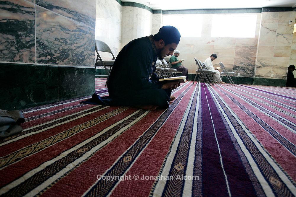 A man reads the Koran inside the King Fahd Mosque in Culver City, California on the second Friday of Ramadan after the midday prayer services during the holiest of months in the Islamic calendar. Fasting in the month of Ramadan is one of the Five Pillars of Islam. The month is spent by Muslims fasting during the daylight hours from dawn to sunset.