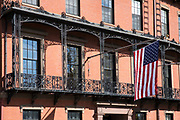 Patriotic Stars and Stripes flag on flagpole at the Union Club in Park Street, Boston, Massachusetts, USA