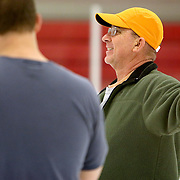 Shep Sheppard directs a teammate during a curling match at the Wilmington Ice House. (Jason A. Frizzelle)