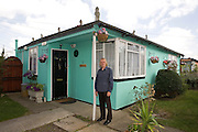 Jim Blackender in front of his prefab in 2009. Jim fought and lost. He raised an army of residents to save the prefabs from demolition but the battle ended up in a ballot which led by 54% to 46% to the 'regeneration' of the estate. By regeneration, the council means demolition of the post-war bungalows and replacement with double and triple storeys dwellings. The idea is to triple the density of the population but it's difficult to find out more as Lewisham is remaining very discreet about the future. The demolition process should have started in October 2012 but in June 2013, it still hadn't begun. On the estate, more and more prefabs are being boarded up. Residents were hoping they would be rehoused in new houses at the same location but it doesn't look like it will happen, so they are ending up accepting other housing options offered by the council as Jim and his wife Lauren did. In September 2012, they left their prefab for good for a 2 bedroom attached house in Rochester, Kent. I paid them a visit in Winter 2013. They both became very emotional when talking about their prefab. The scar hasn't healed yet. <br />