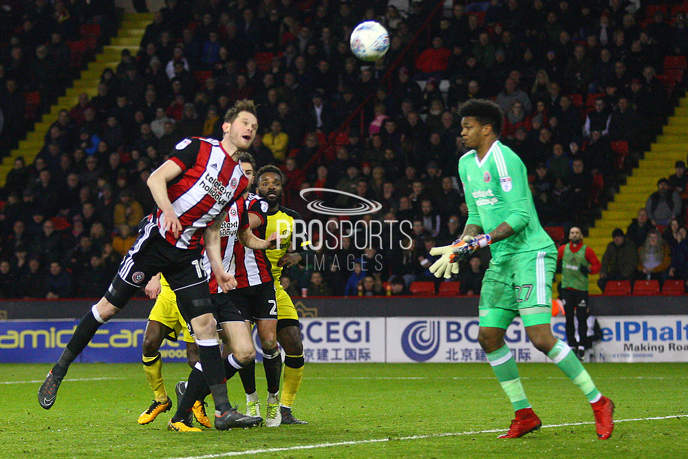 Sheffield United's Richard Stearman heads the ball out of danger during the EFL Sky Bet Championship match between Sheffield United and Burton Albion at Bramall Lane, Sheffield, England on 13 March 2018. Picture by John Potts.