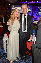 MARYAM D'ABO and RUPERT EVERETT at the Chain of Hope Ball held in aid of the charity Chain of Hope, founded by Professor Sir Magdi Yacoub which organises volunteer teams worldwide to operate on children suffering from life-threatening heart diseases, held at the Grosvenor House Hotel, Park Lane, London on 20th November 2015.