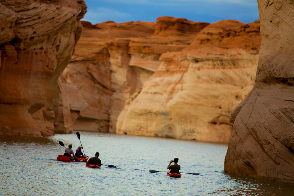 A Kayaker captures the moment while making their way thru the spellbinding Antelope Canyon section of Lake Powell.