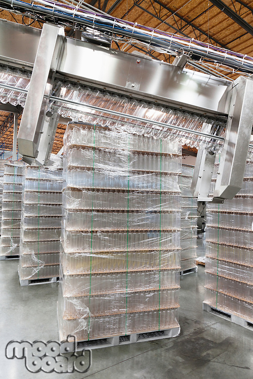 Stack of bottled water kept in warehouse