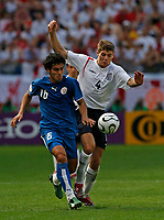 Photo: Glyn Thomas.<br />England v Paraguay. Group B, FIFA World Cup 2006. 10/06/2006.<br /> England's Steven Gerrard (L) and Paraguay's Cristian Riveros.