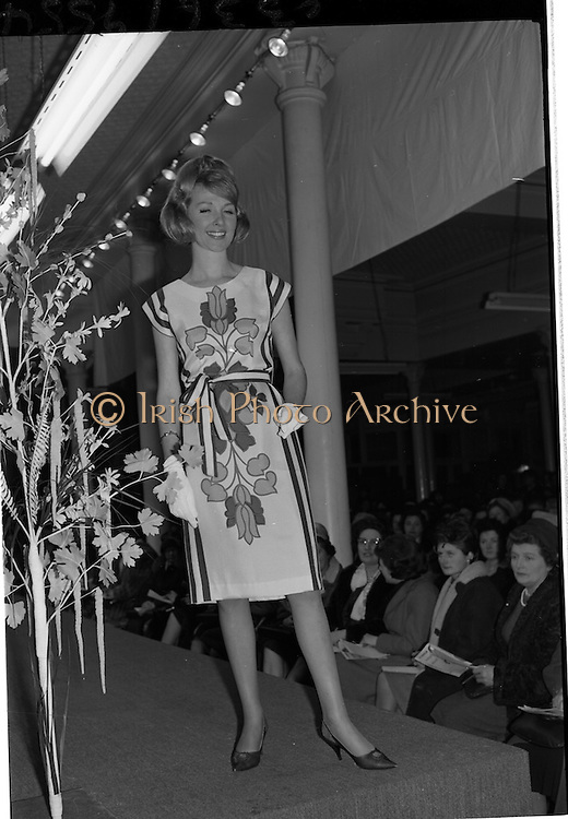 09/03/1964<br /> 03/09/1964<br /> 09 March 1964<br /> McBirney's Fashion show at McBirney's, Aston Quay, Dublin. Image shows model Blanche wearing a white frock.