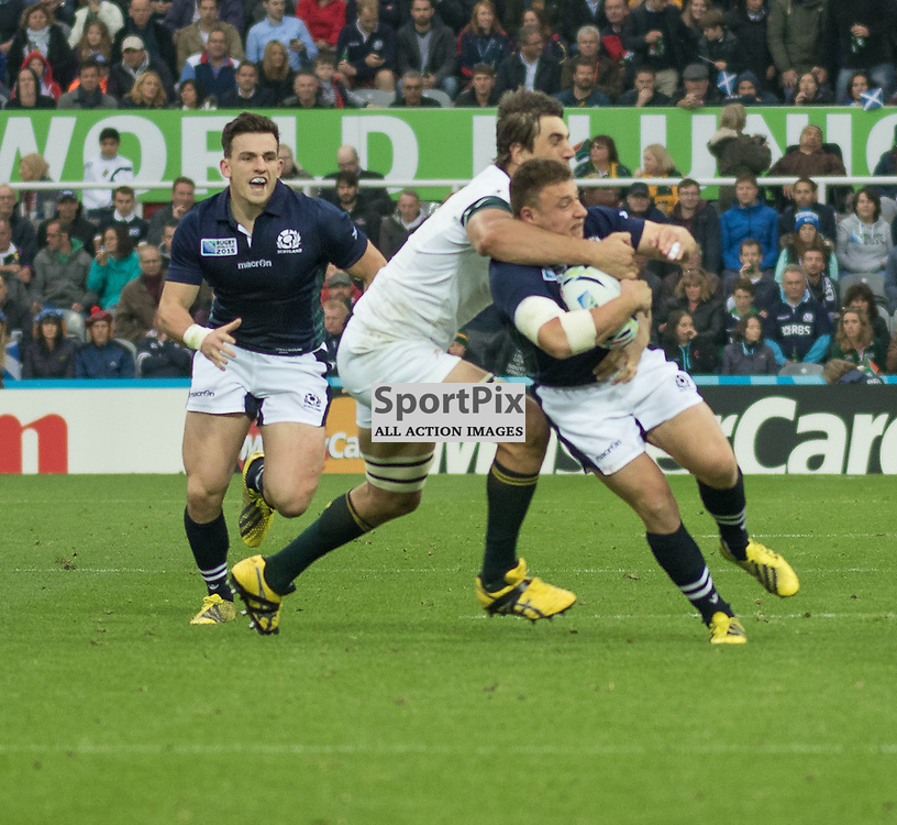 South Africa #4. Eben Etzebeth puts in a high tackle on Scotland's Duncan Weir.  South Africa v Scotland, 3rd October 2015