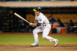 OAKLAND, CA - SEPTEMBER 09:  Joey Wendle #52 of the Oakland Athletics hits an RBI single against the Seattle Mariners during the fifth inning at the Oakland Coliseum on September 9, 2016 in Oakland, California. The Seattle Mariners defeated the Oakland Athletics 3-2. (Photo by Jason O. Watson/Getty Images) *** Local Caption *** Joey Wendle