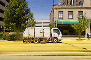 Scranton, Pa. - AS City of Scranton Department of Public Works truck tries to clean yellow powder off the street after the Color Me Rad 5K color run on May 24, 2015.