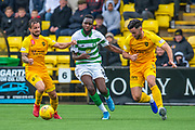 Odsonne Edouard (#22) of Celtic FC is sandwiched between Keaghan Jacobs (#7) and Ricki Lamie (#5) of Livingston FC during the Ladbrokes Scottish Premiership match between Livingston FC and Celtic FC at The Tony Macaroni Arena, Livingston, Scotland on 6 October 2019.