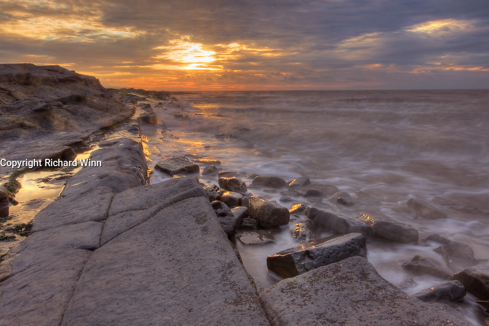 HDR image of Kilve Beach. The incoming tide made the margin for error very small, as the tidal range in the Bristol Channel and Severn Estuary is one of the largest in the world, making the danger of getting cut off very real. Not to mention the amount of spray in the wind, which also meant I had to hold onto the tripod for additional support. A blend of three exposures, using HDR enhanced the other-wordly look of the coastline.