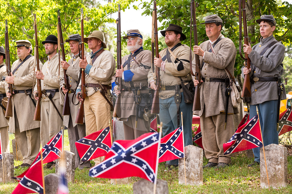 Civil War re-enactors stand in silence during Confederate Memorial Day events at Magnolia Cemetery April 10, 2014 in Charleston, SC. Confederate Memorial Day honors the approximately 258,000 Confederate soldiers that died in the American Civil War.