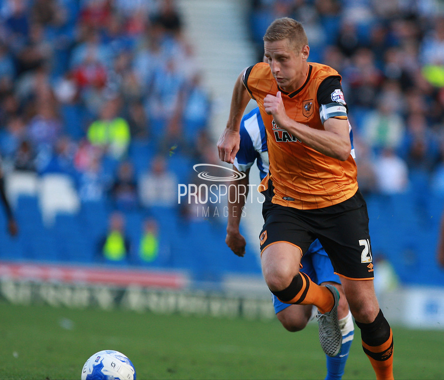 Hull City defender Michael Dawson brings the ball forward during the Sky Bet Championship match between Brighton and Hove Albion and Hull City at the American Express Community Stadium, Brighton and Hove, England on 12 September 2015. Photo by Bennett Dean.