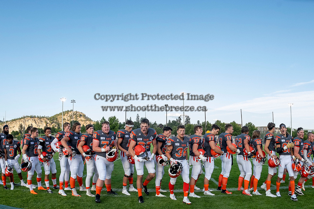KELOWNA, BC - AUGUST 3:  The Okanagan Sun line up walk to the bench at the start of the game against the Kamloops Broncos at the Apple Bowl on August 3, 2019 in Kelowna, Canada. (Photo by Marissa Baecker/Shoot the Breeze)