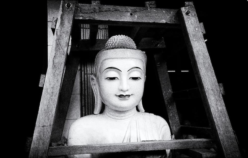 A newly made Buddha, ready for shipping. Yangon (Rangoon) Myanmar (Burma) January 2012