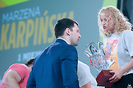 (L) Szymon Kolecki - President of Polish Weightlifting Federation (former weightlifter, silver medallist Olympic Games at 2000 in Sydney and 2008 in Beijing) and (R) Marzena Karpinska from Poland (48kg category) with the Cup while victory ceremony during Women's Weightlifting Polish Cup 2014 in Jozefow near Warsaw on March 30, 2014.<br /> Marzena Karpinska won the first Women's Weightlifting Polish Cup.<br /> <br /> Poland, Jozefow, March 30, 2014<br /> <br /> Picture also available in RAW (NEF) or TIFF format on special request.<br /> <br /> For editorial use only. Any commercial or promotional use requires permission.<br /> <br /> Mandatory credit:<br /> Photo by © Adam Nurkiewicz / Mediasport