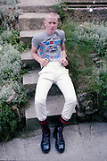 Paul sat on steps in Hawthorne Road, High Wycombe, UK, 1980s