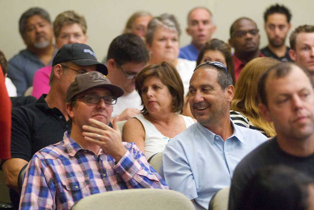 Bloggers Travis Kiger, in hat, and Tony Bushala, joke around at a Fullerton City Council Meeting where public comments dominated the session.  Discussed was the death of Kelly Thomas, a mentally ill homeless man that died after an altercation with FUllerton Police. During the months since, two FPD officers have been charged with 2nd dgree murder and involuntary manslaughter and ar ecall campaign has begun agains three seated council members.