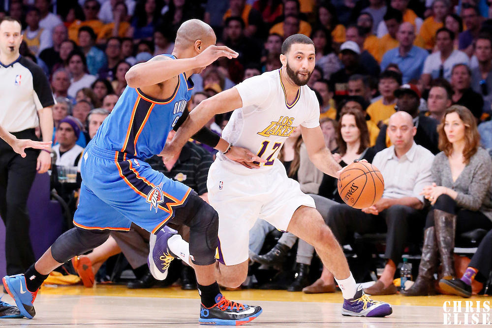 09 March 2014: Los Angeles Lakers point guard Kendall Marshall (12) drives pst Oklahoma City Thunder small forward Caron Butler (2) during the Los Angeles Lakers 114-110 victory over the Oklahoma City Thunder at the Staples Center, Los Angeles, California, USA.