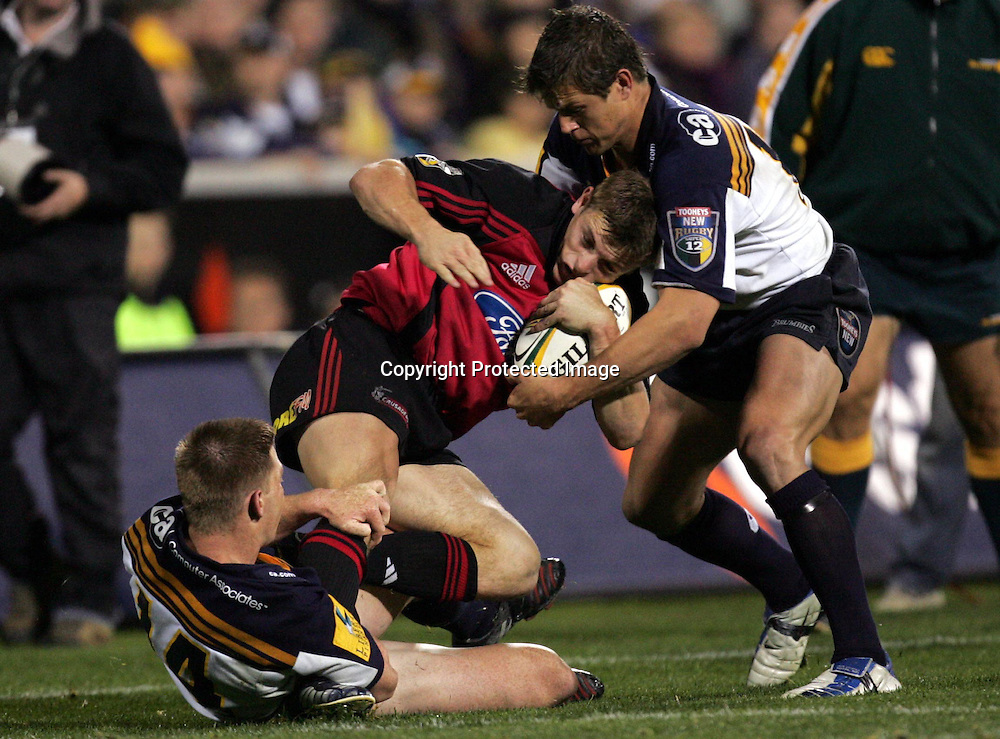 22 May, 2004. Super 12 Final, Canberra Stadium, Canberra ACT, Australia.<br /> Ben Blair gets caught up in tight Brumbies defence. The Brumbies defeated the Crusaders  48-37<br /> Please credit: Andrew Cornaga/Photosport