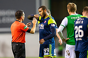Marios Ogboe (#99) of Hamilton Academical FC speaks to referee Andrew Dallas about being elbowed during the Ladbrokes Scottish Premiership match between Hibernian FC and Hamilton Academical FC at Easter Road Stadium, Edinburgh, Scotland on 22 January 2020.
