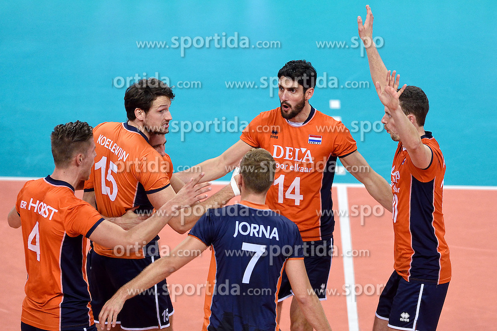 Thomas Koelewijn #15, Niels Klapwijk #14, Jeroen Rauwerdink #10 during volleyball match between National teams of Netherlands and Slovenia in Playoff of 2015 CEV Volleyball European Championship - Men, on October 13, 2015 in Arena Armeec, Sofia, Bulgaria. Photo by Ronald Hoogendoorn / Sportida