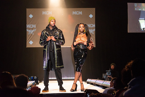 Two models in MCM-brand streetwear pose on the runway at the Howard University Annual Fashion Show.