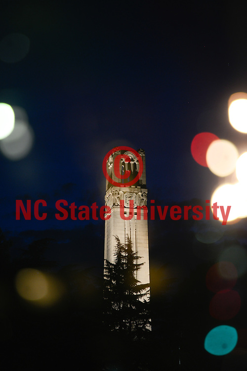 The NC State Belltower at dusk and night. Photo by Marc Hall
