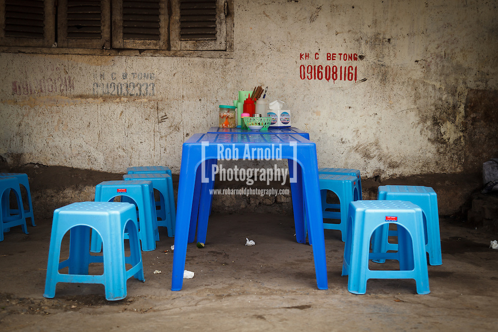 15/04/2013 - Hanoi, Vietnam. A plastic table and chairs on a Hanoi street. These are typically used for eating Phở, the traditional Vietnamese soup. Photo by Rob Arnold