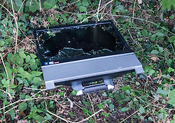 © Licensed to London News Pictures. 28/06/2018. Fetcham, UK. A broken TV is left behind after travellers left Fetcham Recreation ground. The site was occupied by 18 vehicles on Wednesday 27th June and the occupants were issued with a Notice of Direction requesting that they leave by Mole Valley District Council. This has been ignored and the council went to court to seek further legal action yesterday (28th June 2018). Photo credit: London News Pictures