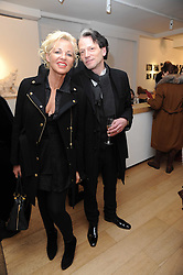 AMANDA ELIASCH and TIM WILLIS at a private view of photographs by Nick Ashley held at the Sladmore Gallery, 32 Bruton Place, London on 13th January 2010.