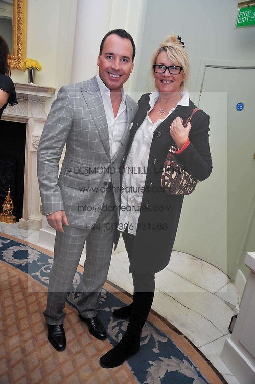 DAVID FURNISH and LOUISE FENNELL at a party to celebrate the publication of Gosling - Classic Design for Contemporary Interiors by Tim Gosling held at William Kent House, The Ritz Hotel, London on 1st October 2009.