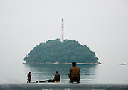 EXCLUSIVE<br /> A Chemical Beach Tour in North Korea<br /> <br /> For a long time, I had wanted to enjoy the beaches of North Korea promoted in official brochures. But the best one &ndash; located on the East Coast in Hamhung, the second largest city in the DPRK with a population of 800,000 &ndash; was not open to tourists. This finally changed in 2011 and I jumped on the opportunity to be one of the first to visit the place.<br /> <br /> My North Korean guide got starry-eyed while talking about this beach. He was extolling the &quot;excellent stretches of pristine beach.&rdquo; I don&rsquo;t think that he ever went there but he learnt the official propaganda by heart.<br /> He told me that every North Korean citizen had the secret dream of enjoying a beach holiday. On the brochure he gave me, it said, &ldquo;Majon, the resort in the suburbs of Hamhung and an industrial city&rdquo; &ndash;&nbsp;an example of North Korean marketing.<br /> <br /> After arriving in Hamhung, a five-hour drive from Pyongyang, I follow the mandatory city tour. One stop in front of the Grand Theatre &ndash; not possible to go inside. I&rsquo;m allowed to open the bus window if I want to take a picture. Another stop in front of Kim Il Sung&rsquo;s giant statue. My guide explains, &ldquo;The hill was built by people so they could erect the statue of the Great Leader Kim Il Sung on top of it. From there, you have a great view over the city. Let&rsquo;s go!&rdquo;<br /> In fact, the view from the top shows a dull city surrounded by the smoke from the factory chimneys as Hamhung is home to the best beach in North Korea but is also an industrial city with many chemical complexes. Everywhere we drive, we see factories when they are not hidden by the chimney smoke.<br /> <br /> My guide tells me that there is no pollution in the city&hellip; I ask him to be serious for once. Perhaps the air is pure in Pyongyang, but in Hamhung, it&rsquo;s another story. But he keeps repeating that the air is pure. Sometimes, too much propaganda kills the propaganda&hellip;<br /> <br /> I am invited to visit the Hungnam Fertilizer Complex. An alarming yellow smoke