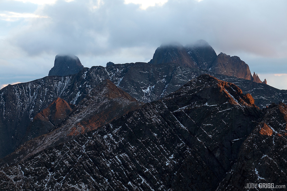 Crestone Needle, left, and Crestone Peak, right are shrouded in clouds at sunset, Sangre De Cristo Range, Colorado.