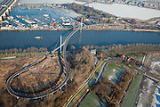 Nederland, Noord-Holland, Amsterdam, 10-01-2009; IJburg: Nesciobrug over Amsterdam-Rijnknaal, hangbrug voor fietsers en voetgangers, verbinding tussen de woonwijk IJburg met de rest van de stad; .de Nesciobrug, suspension bridge for cyclists and pedestrians, important connection for the burough of IJburg . .luchtfoto (toeslag); aerial photo (additional fee required); .foto Siebe Swart / photo Siebe Swart