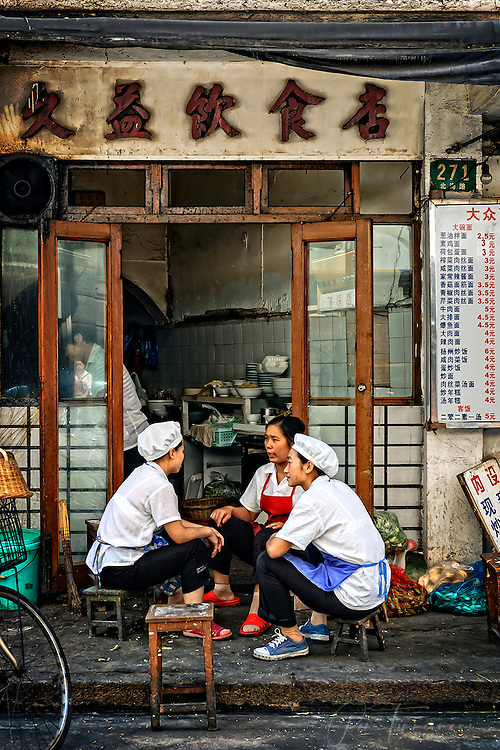 Kitchen personnel taking a break outside their kitchen in Shanghai.