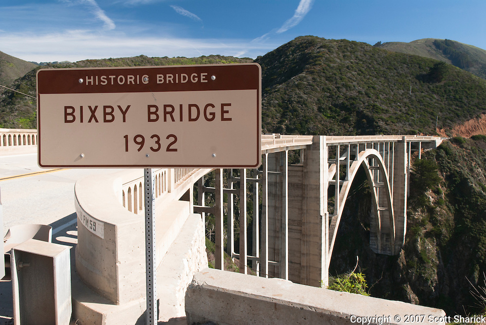 A sign signifies the historic Bixby Bridge on the Pacific Coast Highway in California.