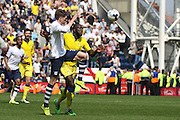 Prestons Adam Reach challenged by Leeds United defender, Souleman Bamba (3) during the Sky Bet Championship match between Preston North End and Leeds United at Deepdale, Preston, England on 7 May 2016. Photo by Pete Burns.