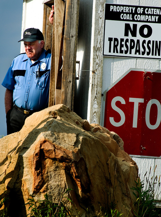 Cross country trip by Greyhound bus. ..First stop: West Virginia - mining and mountaintop removal in the Charleston area..A security guard, guarding the entrance to a mine in Kayford Mountain, West Virginia..Photographer: Chris Maluszynski /MOMENT