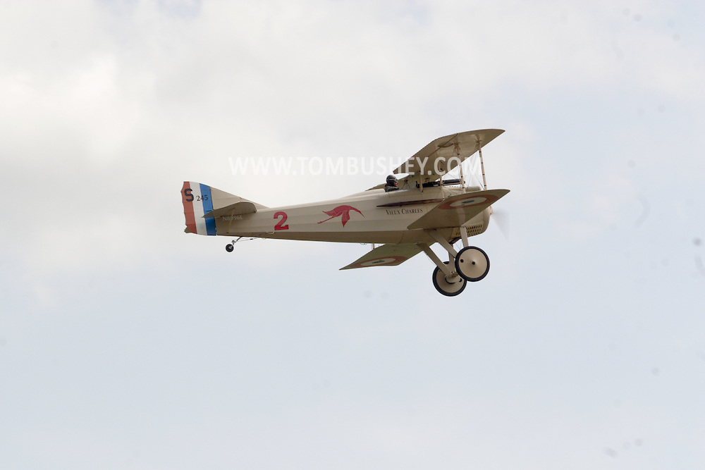 Wurtsboro, NY - A Spad VII reproduction built by Carl Swanson flies above Wurtsboro Airport on May 11, 2008.