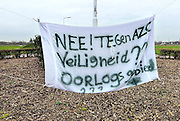 Nederland, the Netherlands, Geldermalsen, 18-12-2015 Tegenstanders van de opvang voor vluchtelingen, azc, hebben spandoeken en protestleuzen in het dorp opgehangen. Na een geweldadige demonstratie afgelopen woensdag is het besluit de besluitvorming, uitgesteld. Geldermalsen, the Netherlands, Demonstration, protest, against the sheltering in a tentcamp near Geldermalsen. In Holland the growing number of refugees forces the government to house them in big centers. Some citizens do not approve and made a violent protest last wendsday. FOTO: FLIP FRANSSEN
