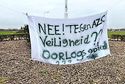 Nederland, the Netherlands, Geldermalsen, 18-12-2015 Tegenstanders van de opvang voor vluchtelingen, azc, hebben spandoeken en protestleuzen in het dorp opgehangen. Na een geweldadige demonstratie afgelopen woensdag is het besluit de besluitvorming, uitgesteld. Geldermalsen, the Netherlands, Demonstration, protest, against the sheltering in a tentcamp near Geldermalsen. In Holland the growing number of refugees forces the government to house them in big centers. Some citizens do not approve and made a violent protest last wendsday. FOTO: FLIP FRANSSEN