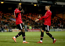 Manchester United's Romelu Lukaku (left) celebrates scoring his side's fourth goal of the game with team-mate Marcos Rojo during the Emirates FA Cup, fourth round match at Huish Park, Yeovil.