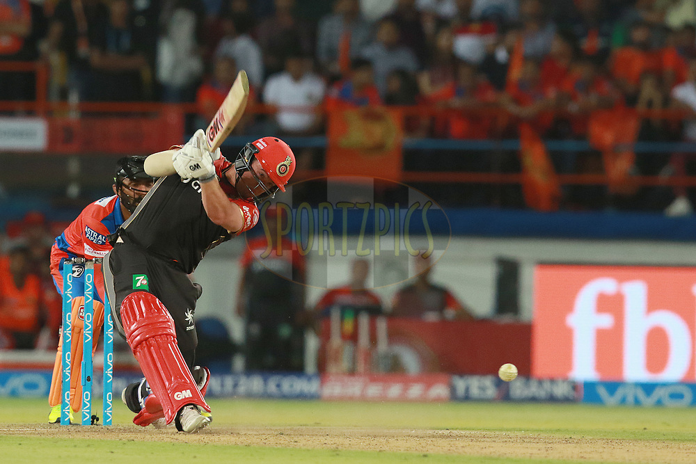 Travis Head of RCB plays a shot during match 20 of the Vivo 2017 Indian Premier League between the Gujarat Lions and the Royal Challengers Bangalore  held at the Saurashtra Cricket Association Stadium in Rajkot, India on the 18th April 2017<br /> <br /> Photo by Rahul Gulati - Sportzpics - IPL
