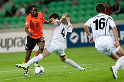 Queensy Menig of Netherlands vs Nika Tchanturia of Georgia during the UEFA European Under-17 Championship Group A semifinal match between Netherlands and Georgia on May 13, 2012 in SRC Stozice, Ljubljana, Slovenia. (Photo by Matic Klansek Velej / Sportida.com)