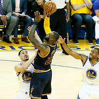 01 June 2017: Cleveland Cavaliers forward LeBron James (23) takes a jump shot over Golden State Warriors guard Klay Thompson (11) past Golden State Warriors forward Andre Iguodala (9) during the Golden State Warriors 113-90 victory over the Cleveland Cavaliers, in game 1 of the 2017 NBA Finals, at the Oracle Arena, Oakland, California, USA.