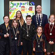 05/03/2019<br /> Pictured are award winners Sarah Lehane, Cara Power, Oliver Sherlock. Molly Ryan, and Roisin Flanagan from St John's NS Cratloe, along with Sara Montoya, co-op member of Fairtrade Colombia, and Cllr Daniel Butler, Mayor of the Metropolitan District of Limerick.<br /> <br /> Fairtrade worker Sara Montoya, from a Fairtrade Coffee Co-op in Colombia was the special guest in Limerick City and County Council chamber today at an event to coincide with Fairtrade Fortnight.<br />  <br /> Sara joined Fairtrade supporters from across Limerick and Ireland for the annual initiative, which features a programme of talks and community events aimed at promoting awareness of Fairtrade and Fairtrade-certified products.<br />  <br /> Speaking at the event in Dooradoyle, Sara outlined the success and benefits of the Fairtrade movement in Colombia and how important it is for people in the developed world think of Fairtrade products when shopping.<br />  <br /> This year's campaign 'Create Fairtrade' invites us all to use our imagination and create fairtrade in our lives.<br />  <br /> Young people from across Limerick city and county were also a focus of the event as they displayed their posters, which they created to help change the way people think about trade and the products on our shelves.<br /> Photo by Diarmuid Greene